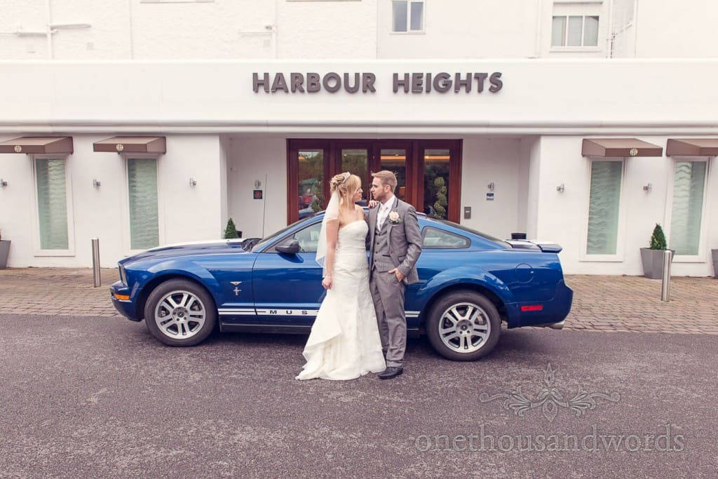 Harbour Heights wedding venue with bride groom and Mustang wedding car