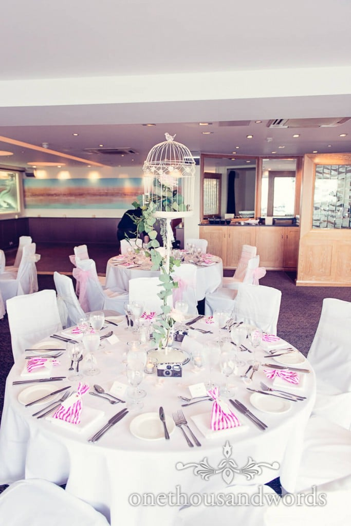 Wedding table at Harbour Heights wedding with floral birdcage decoration
