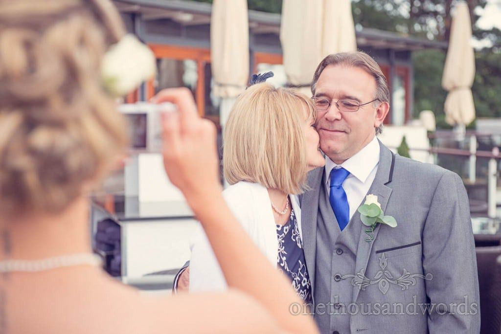 Father of bride poses for family photograph at Harbour Heights wedding