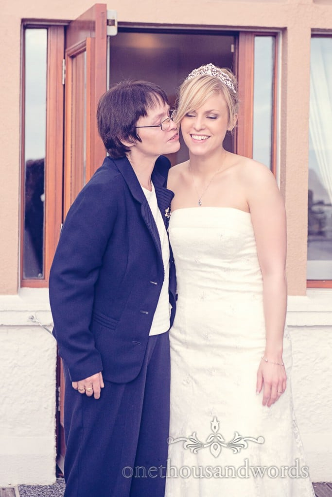 Bride in white wedding dress with mother on wedding day