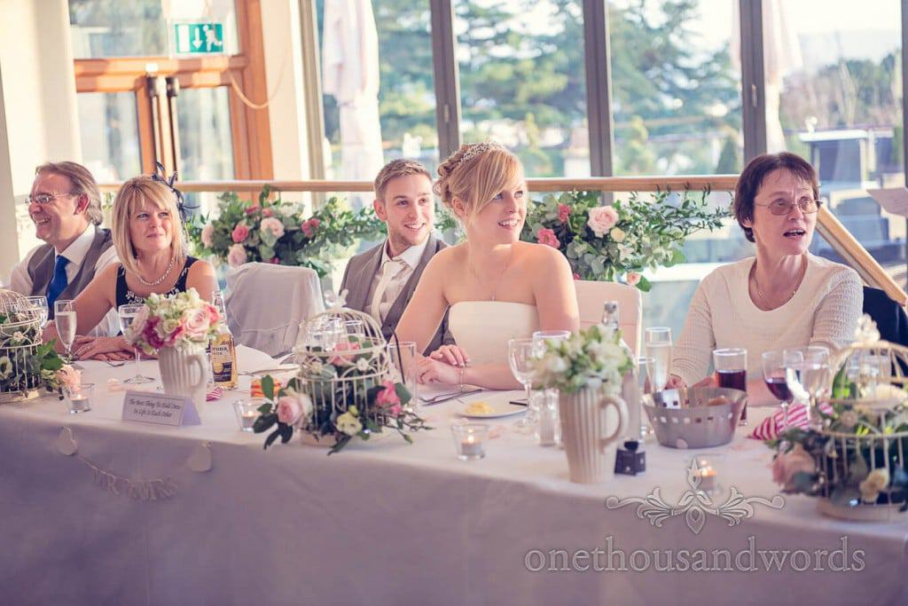 Wedding top table with birdcage flowers and flower jugs