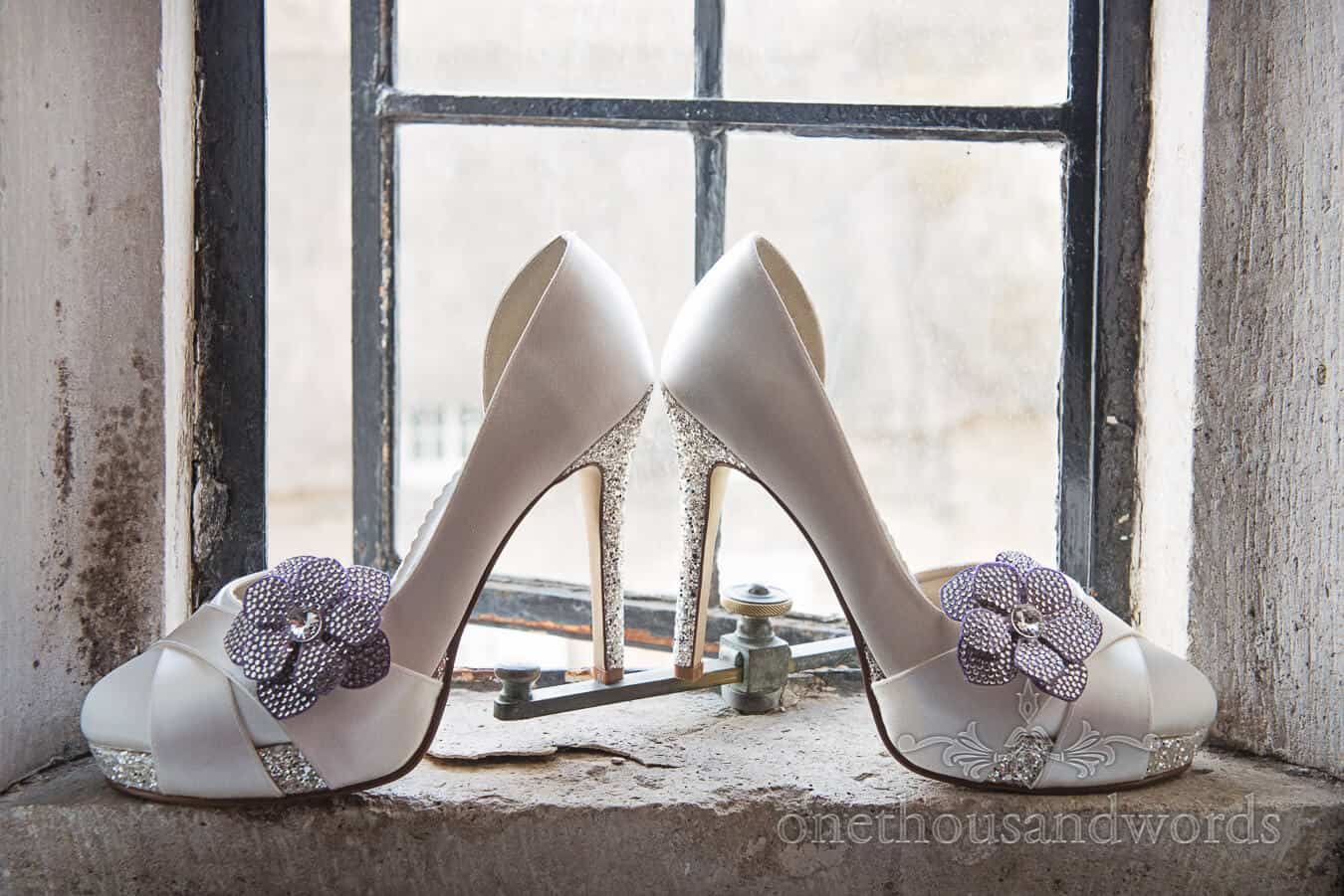 white and silver diamante wedding shoes with high heels and flowers