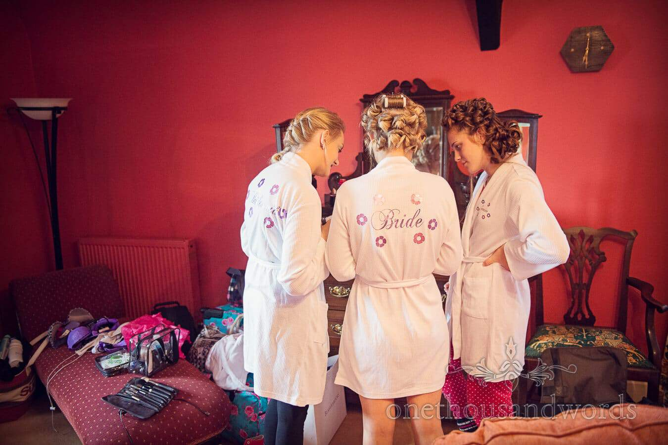 Bridesmaids in team bride dressing gowns at Moretons House Hotel