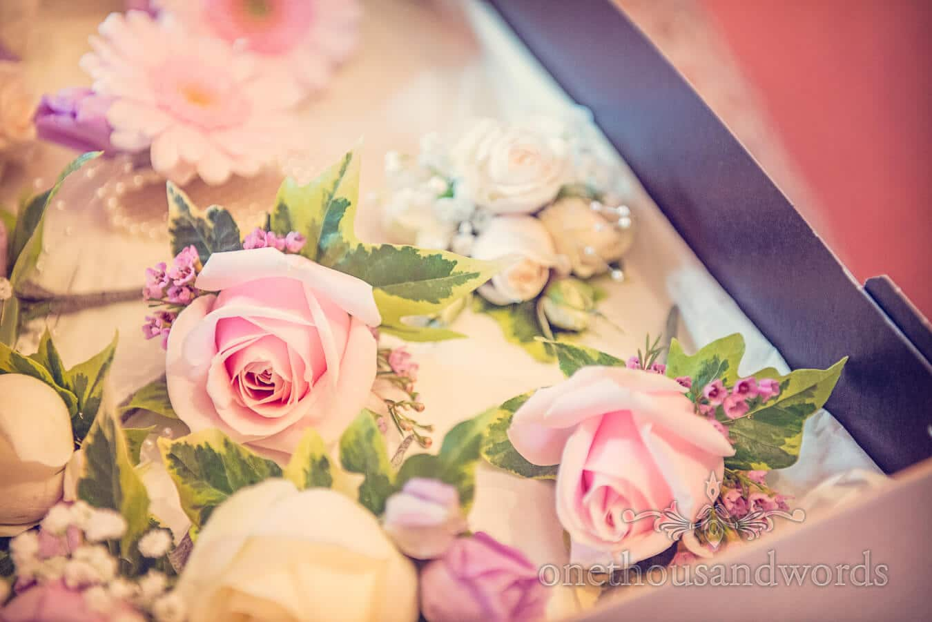 Pink wedding flower buttonholes roses with ivy leaves