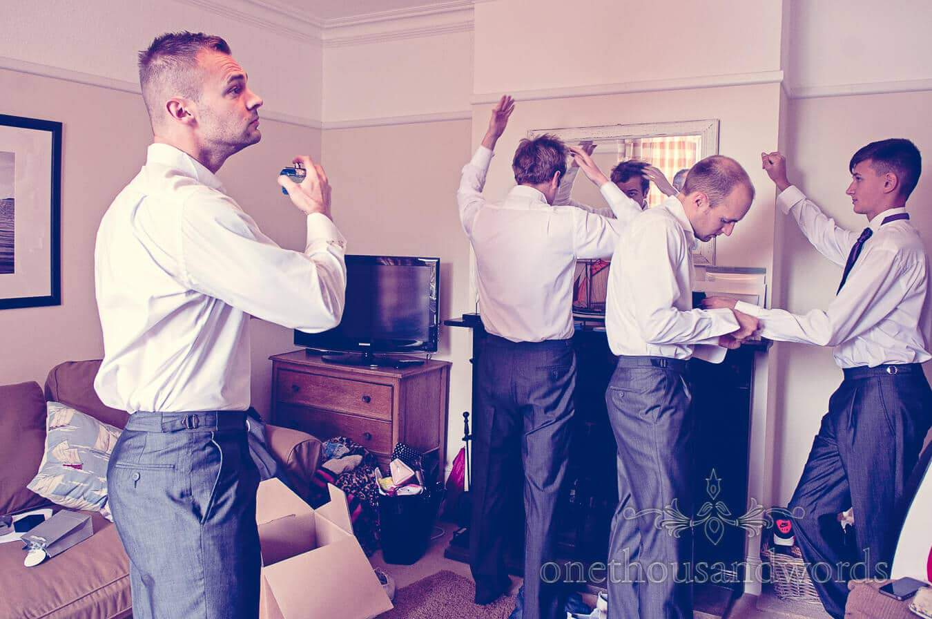 Documentary wedding photo of groomsmen preparing for wedding day