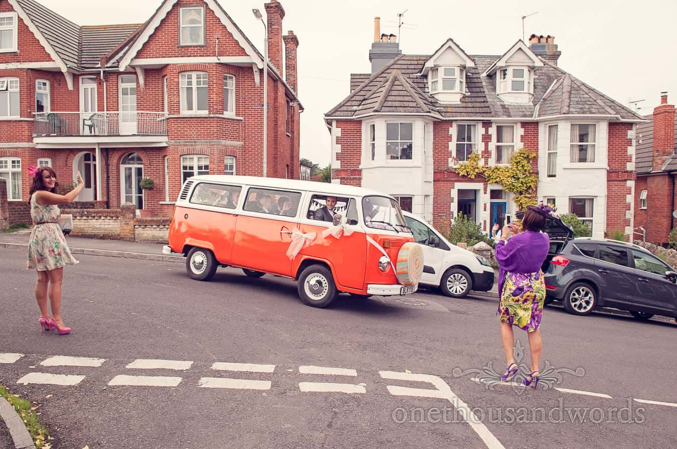 Seaside Wedding Photographs of orange VW weddign van in Swanage