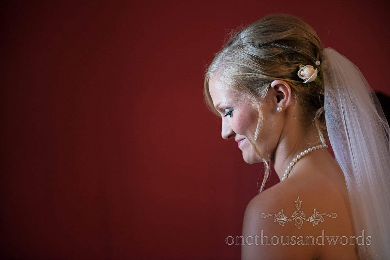Bride portrait photograph natural window lighting on wedding morning in Dorset