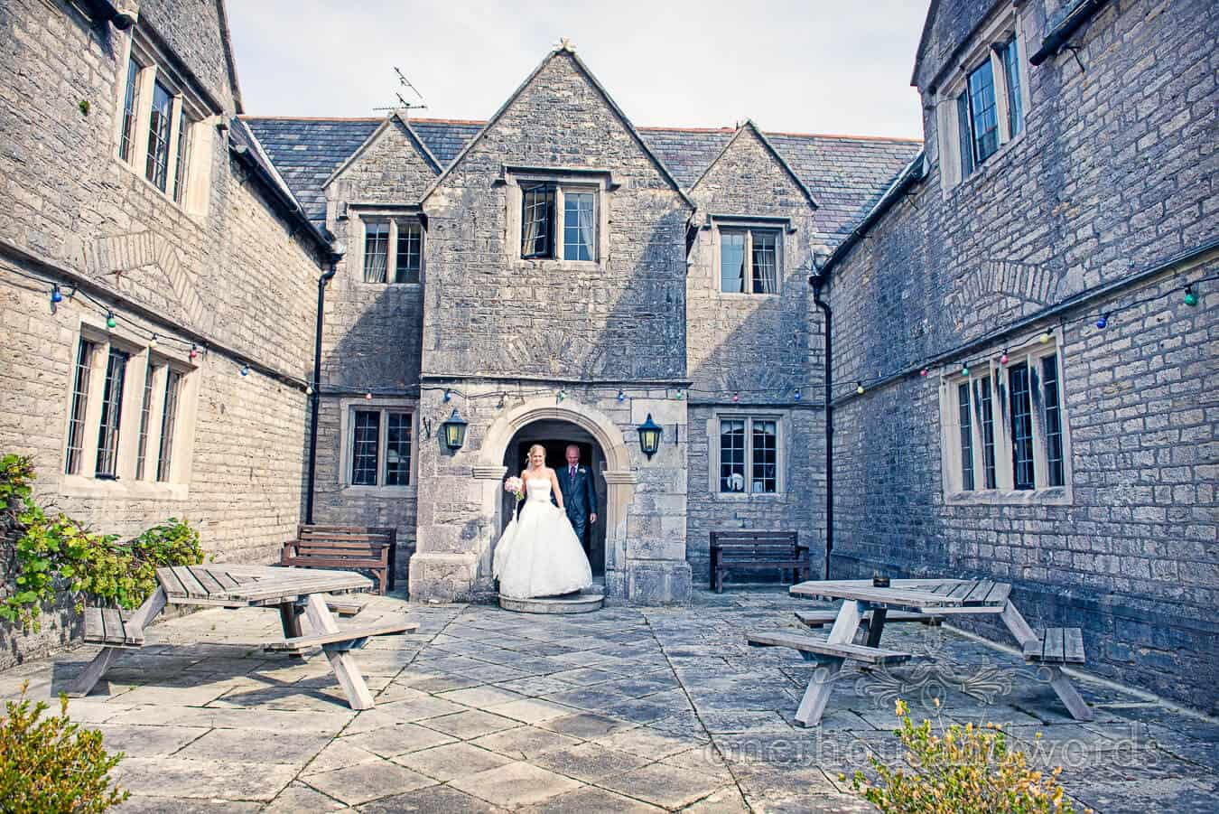 Bride and father leave Mortons House hotel in Corfe Castle Dorset