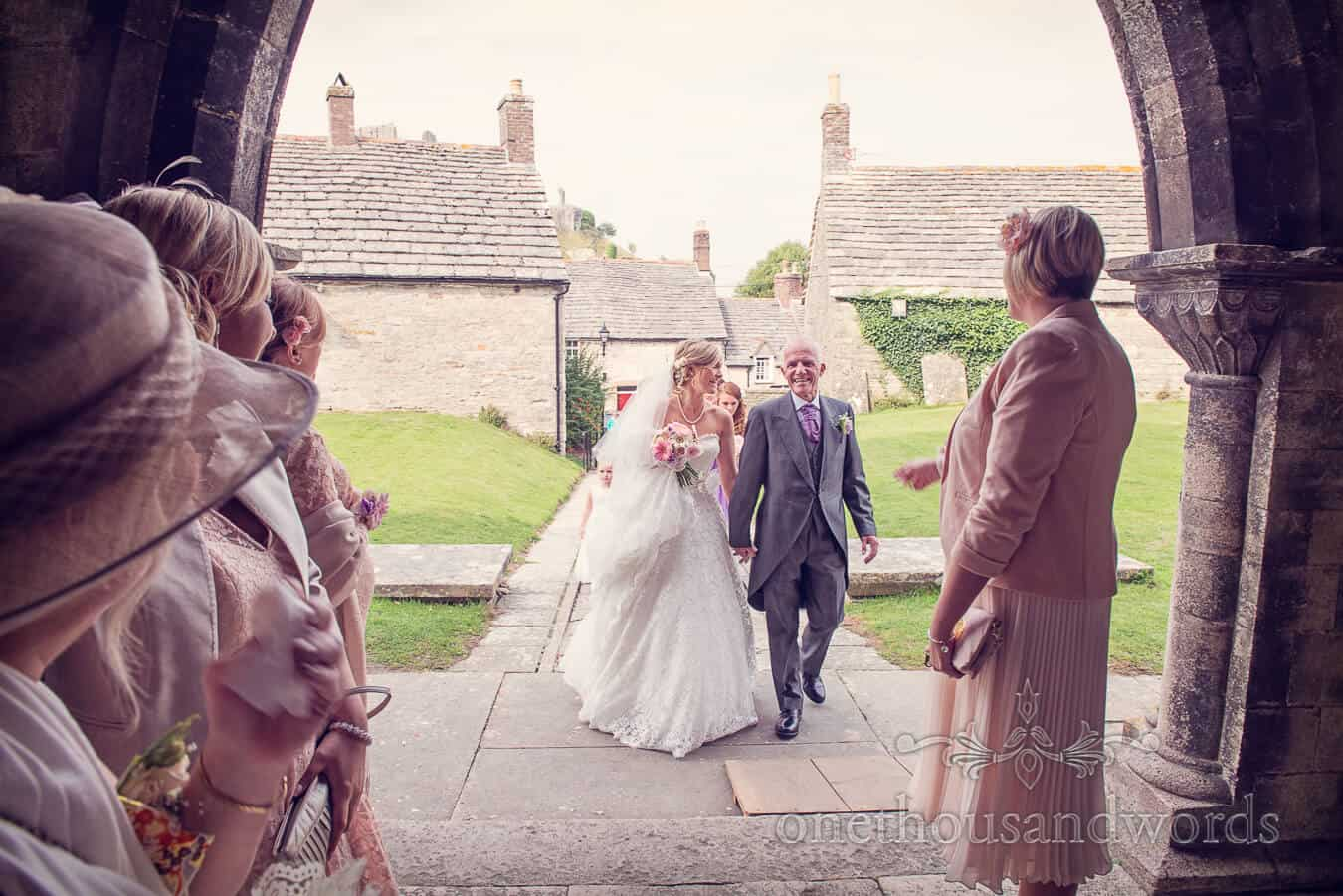 Bride and father arrive at Corfe Castle Church in Dorset