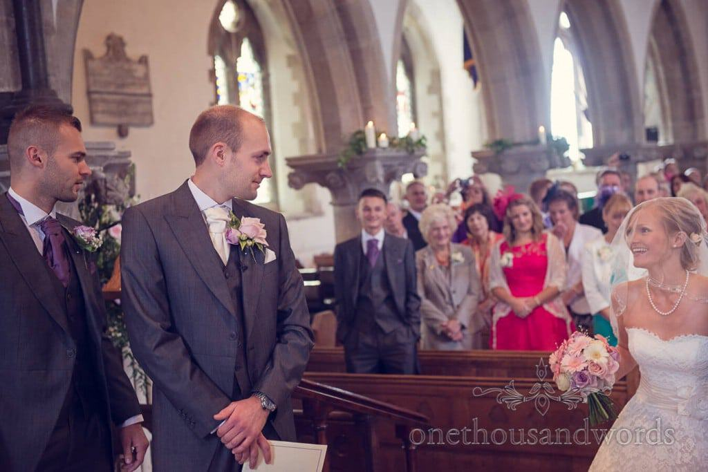 First look wedding photograph at church wedding ceremony in Dorset