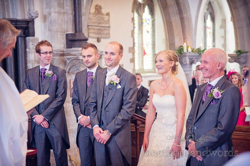 Bride laughing during church wedding ceremony in Dorset