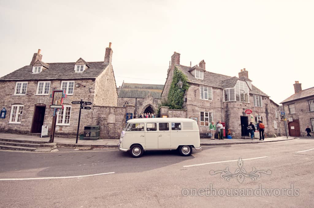 Classic VW wedding van outside Dorset stone village church