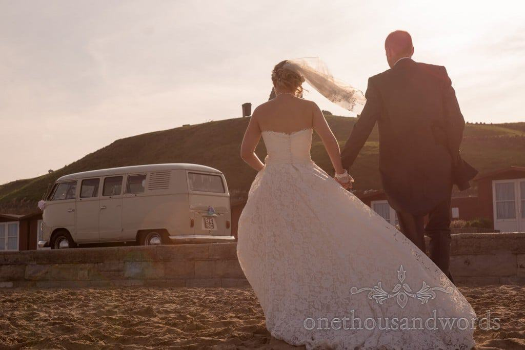 Seaside Wedding Photographs bride and groom with VW van on Swanage beach