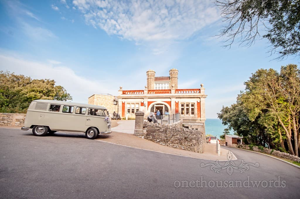 Durlston Castle wedding venue with VW wedding transport by the sea