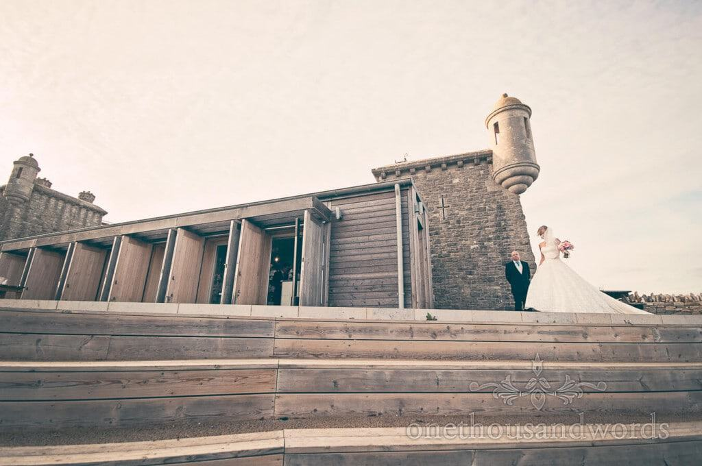 Bride outside Dorset castle wedding venue seaside wedding photographs
