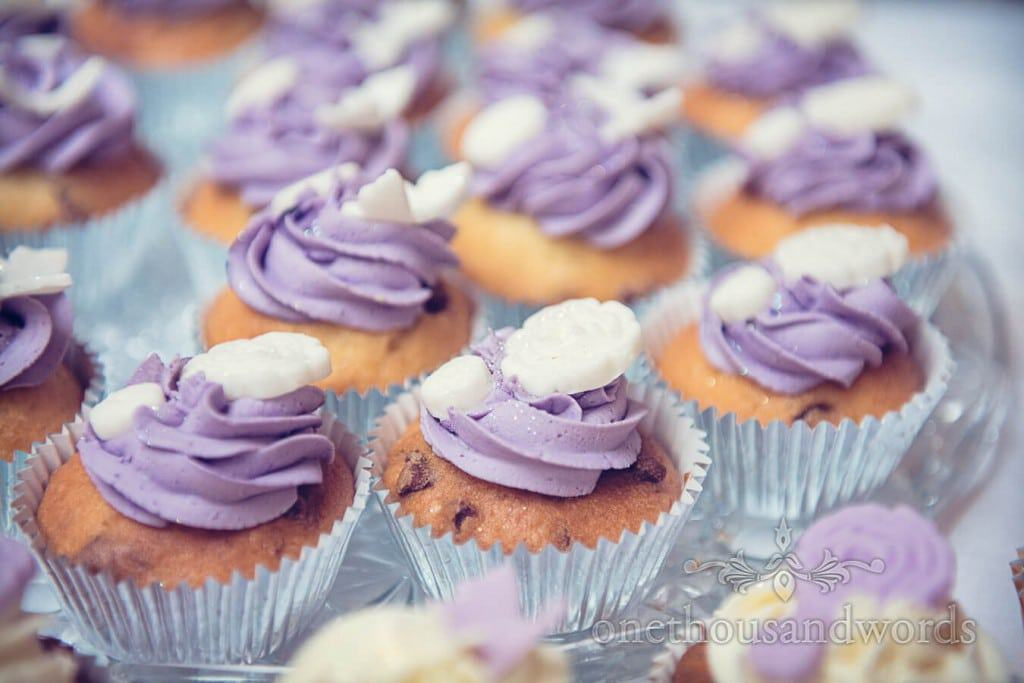 Purple wedding cup cakes with white flower chocolates