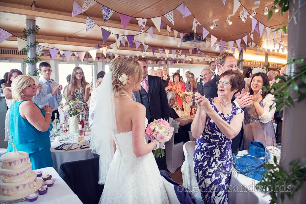 Bride is applauded into wedding breakfast at Durlston Castle