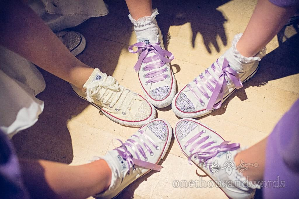 Custom wedding Converse All Stars with diamantes and purple laces