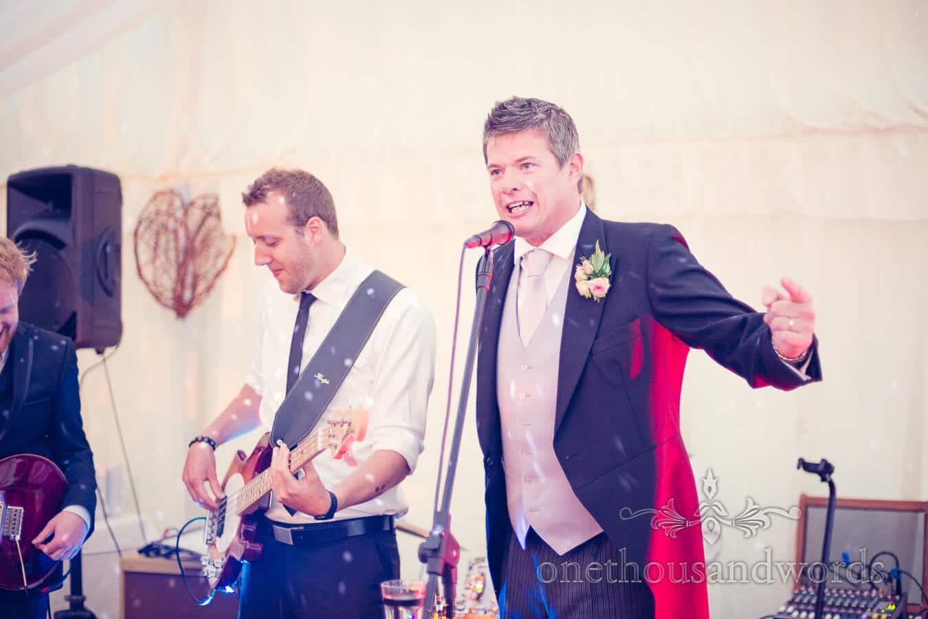 Best man raps to Vanilla Ice with wedding band at evening reception