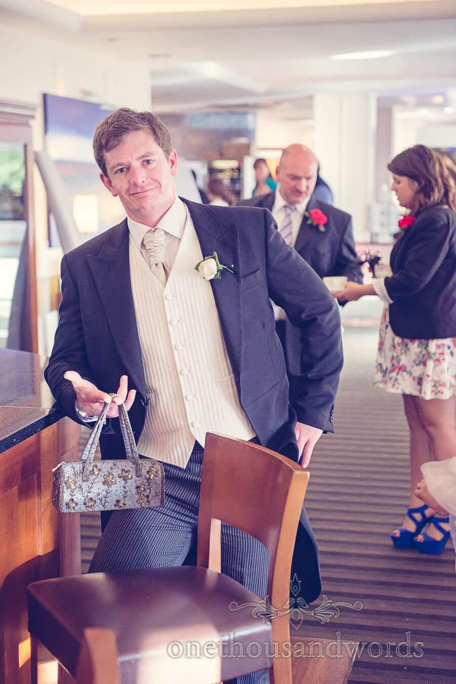 Best Man with handbag at Harbour Heights, Poole wedding venue