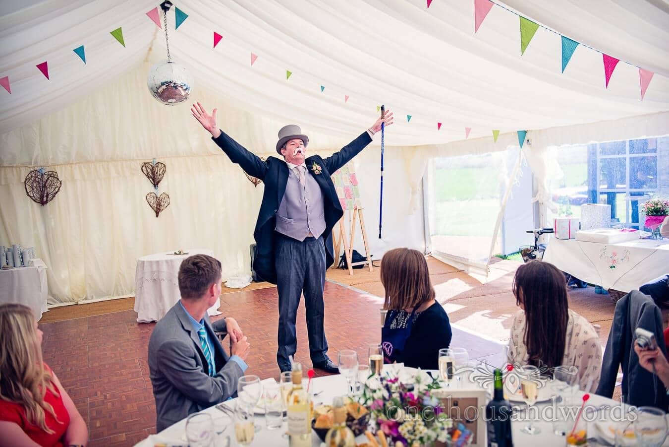 Best man's speech with props in wedding marquee