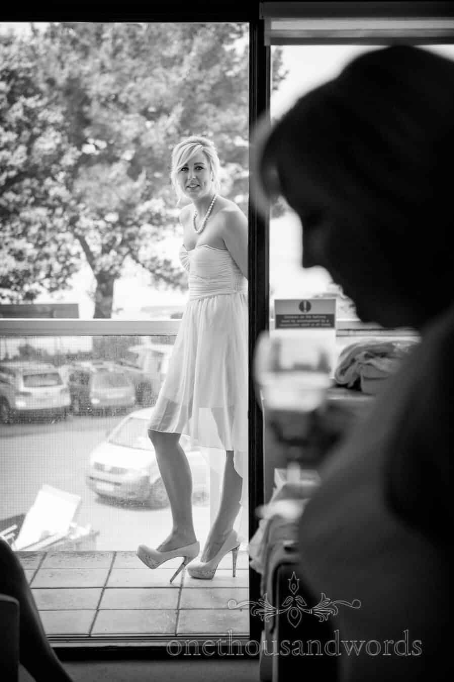 Black and white portrait of bridesmaid at Sandbanks Hotel wedding