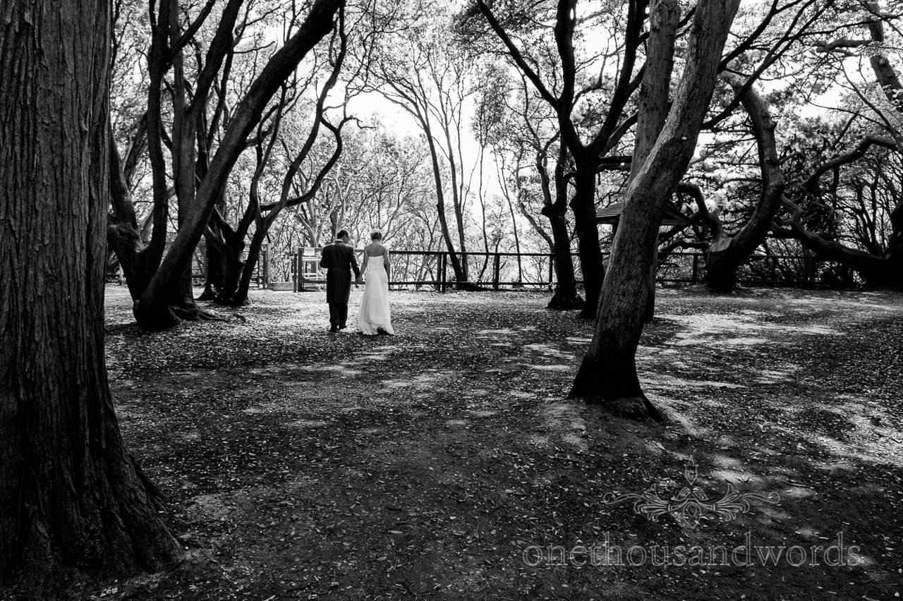 Black and white wedding photograph at Highcliffe Beach