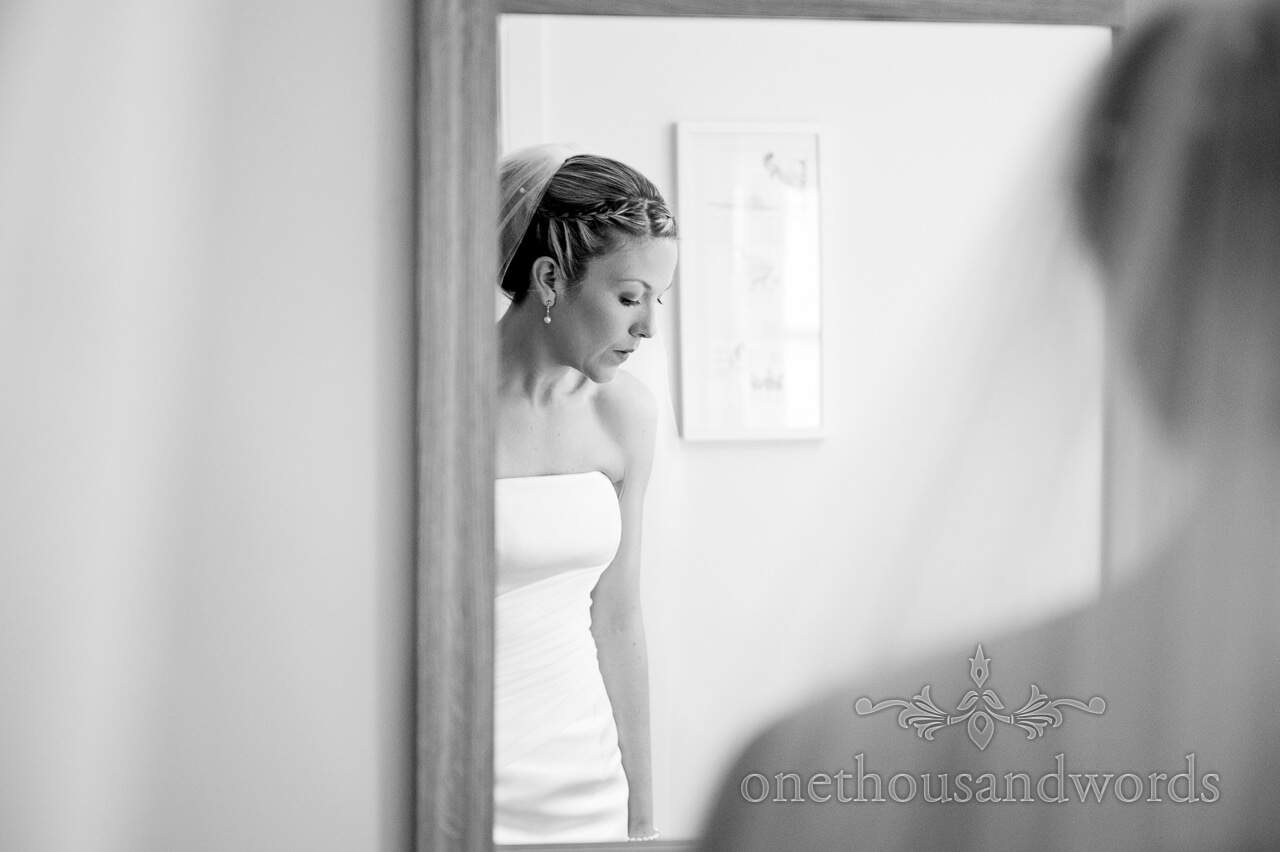 Black and white wedding photograph of bride on wedding morning