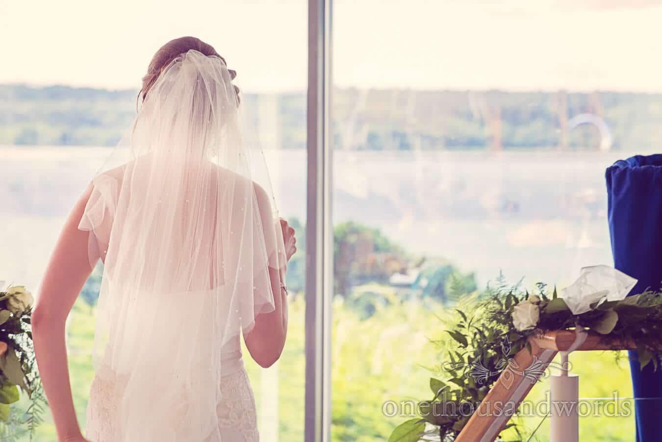 Bride admires sea views at Harbour Heights, Poole wedding venue