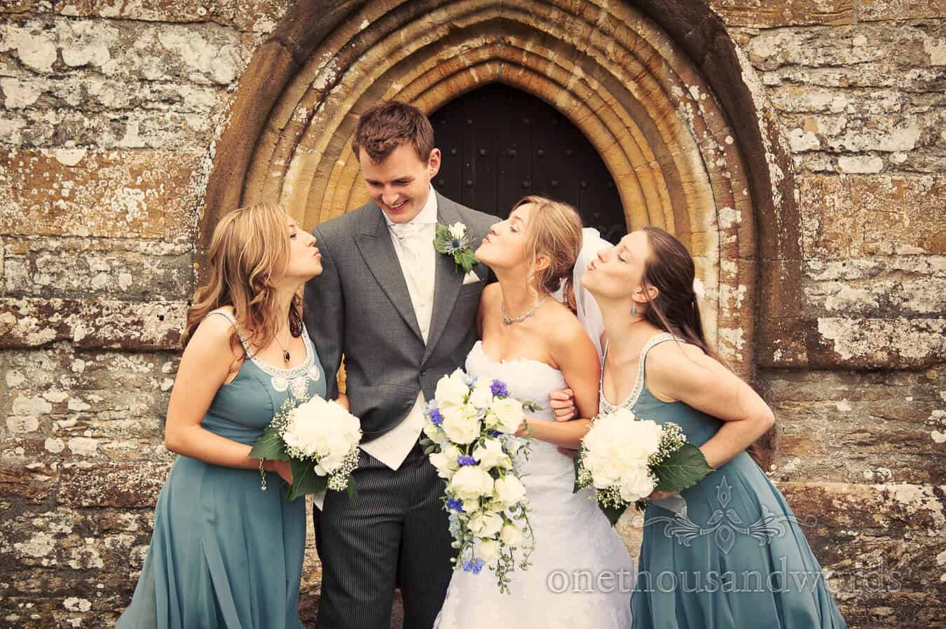Bride and bridesmaids kiss the groom at Country Theme Wedding