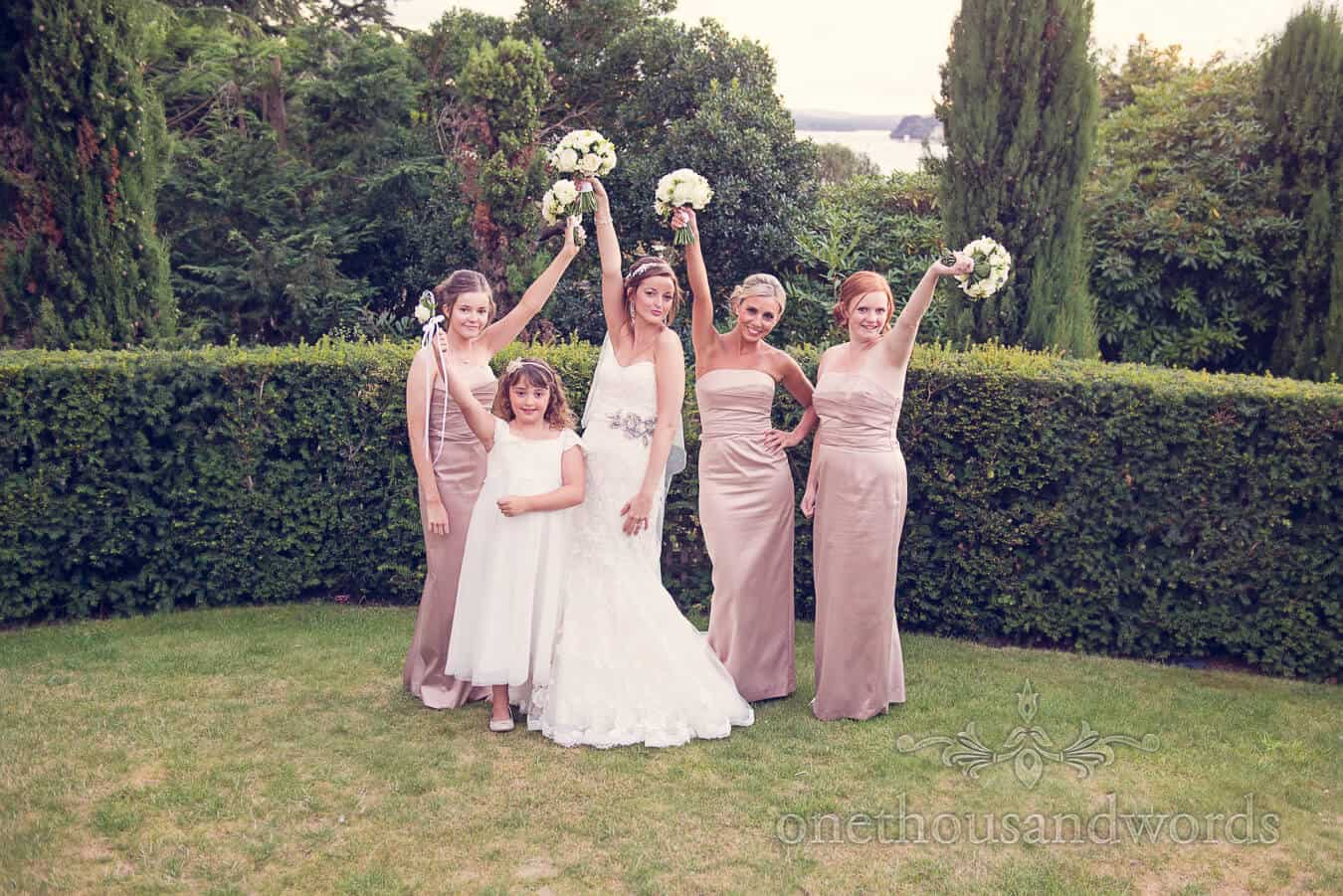 Bride and bridesmaids posing at Harbour Heights, Poole wedding venue