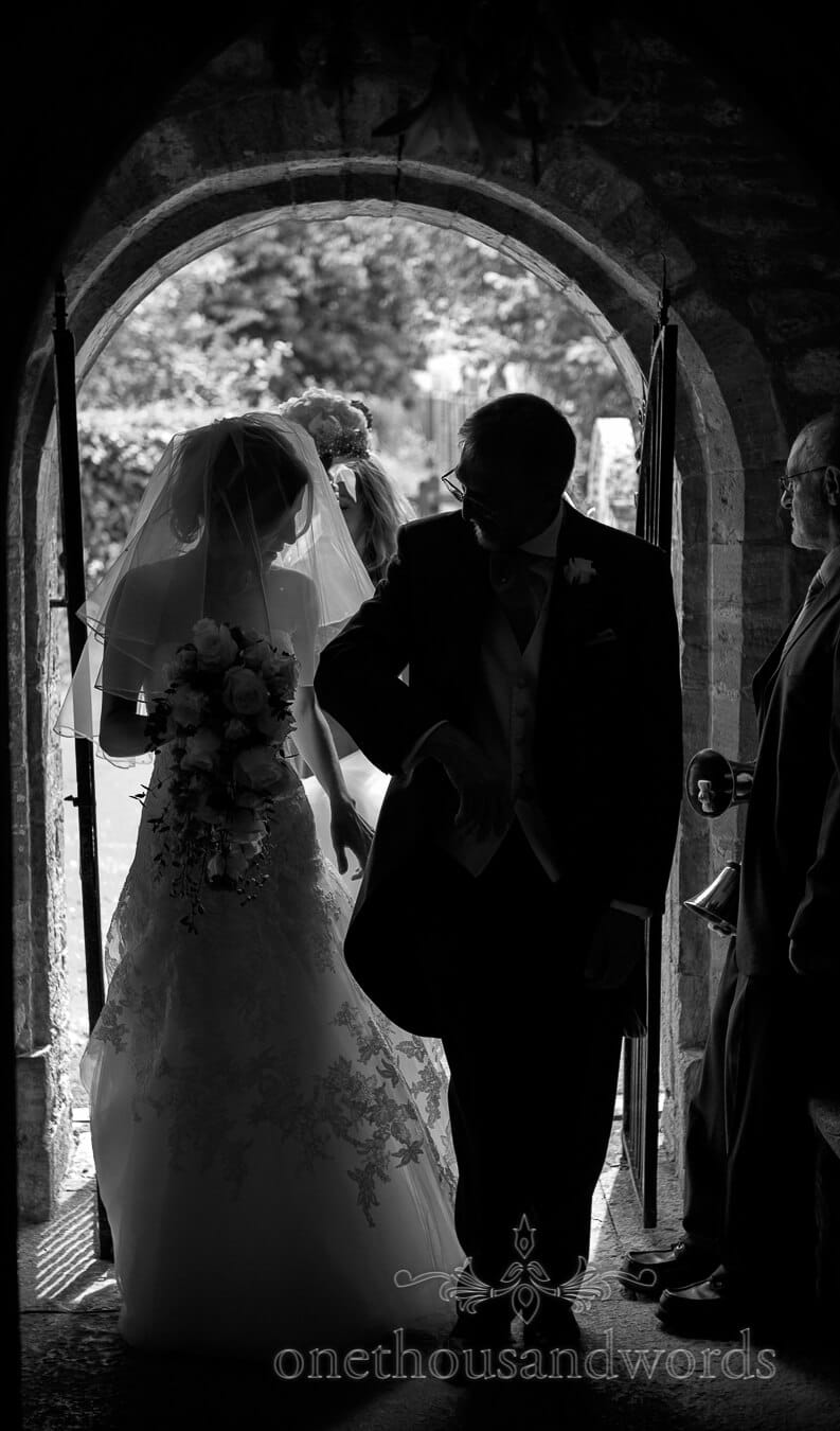 Bride and father of bride enter church at Country Theme Wedding