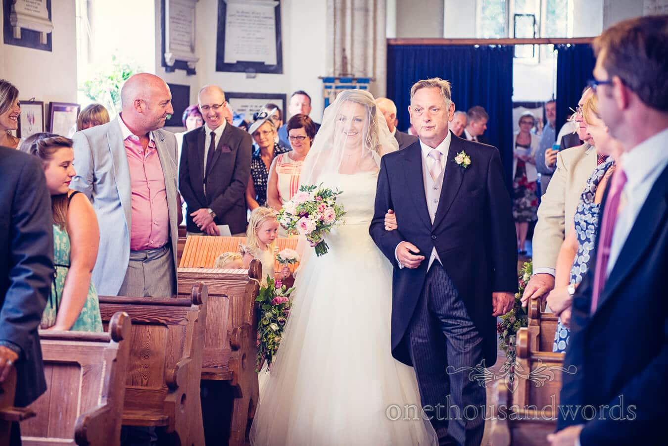 Bride and father walk down aisle at countryside church wedding in Martinstown