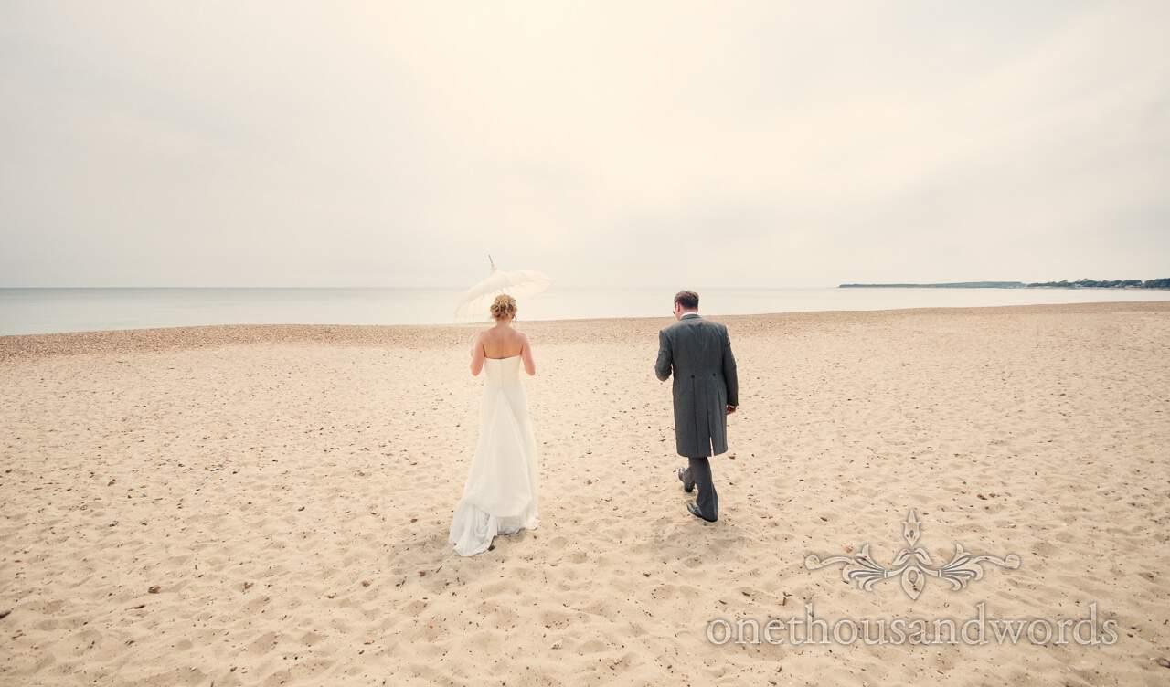 Bride and groom at Highcliffe beach wedding