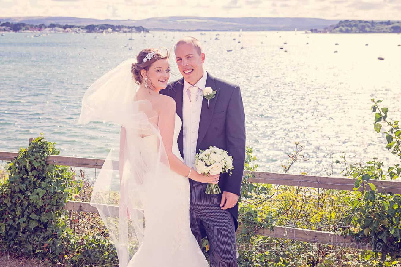 Bride and groom by the sea at Poole wedding venue photograph