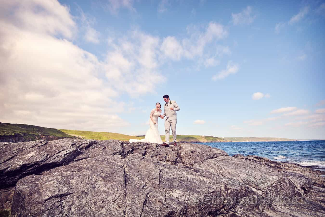 Bride and groom by the sea at Prussia Cove Wedding venue
