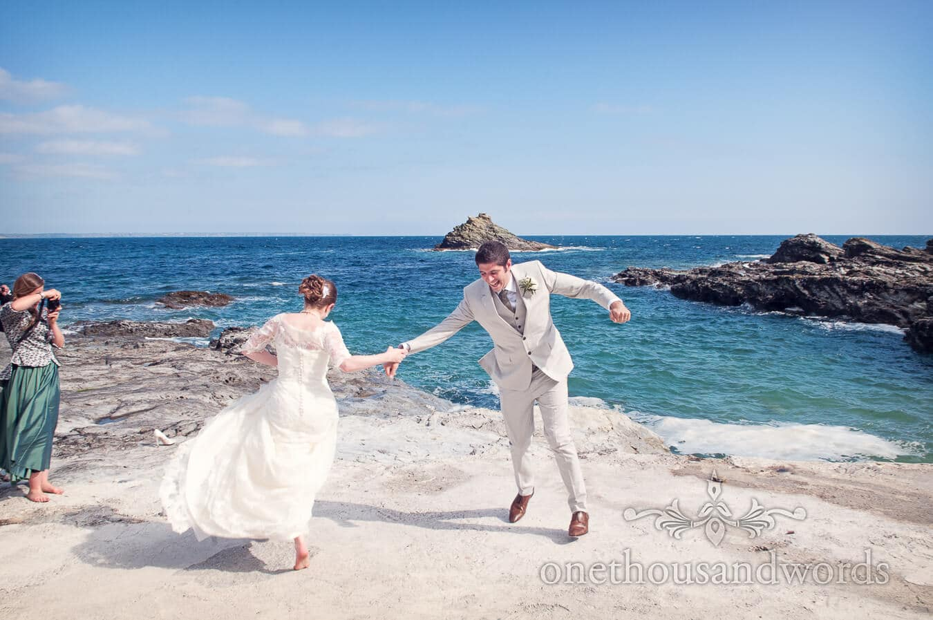Bride and groom dance by the sea at Prussia Cove Wedding