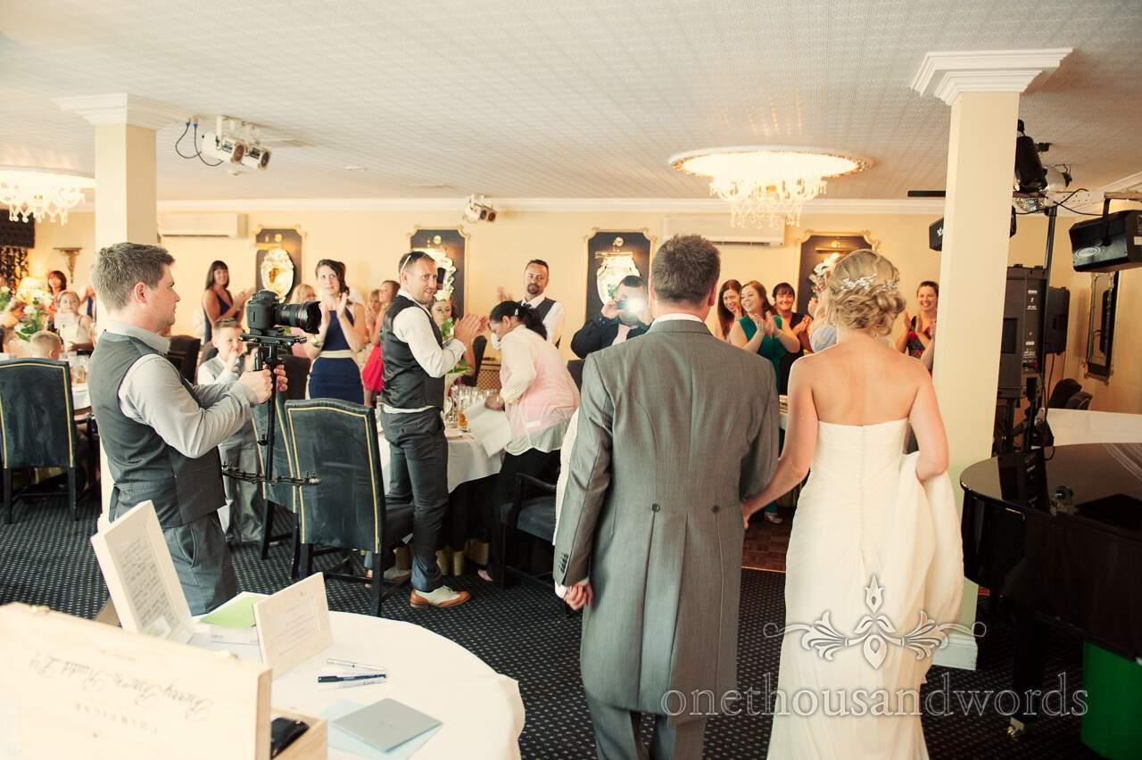Bride and groom enter Lord Bute wedding breakfast