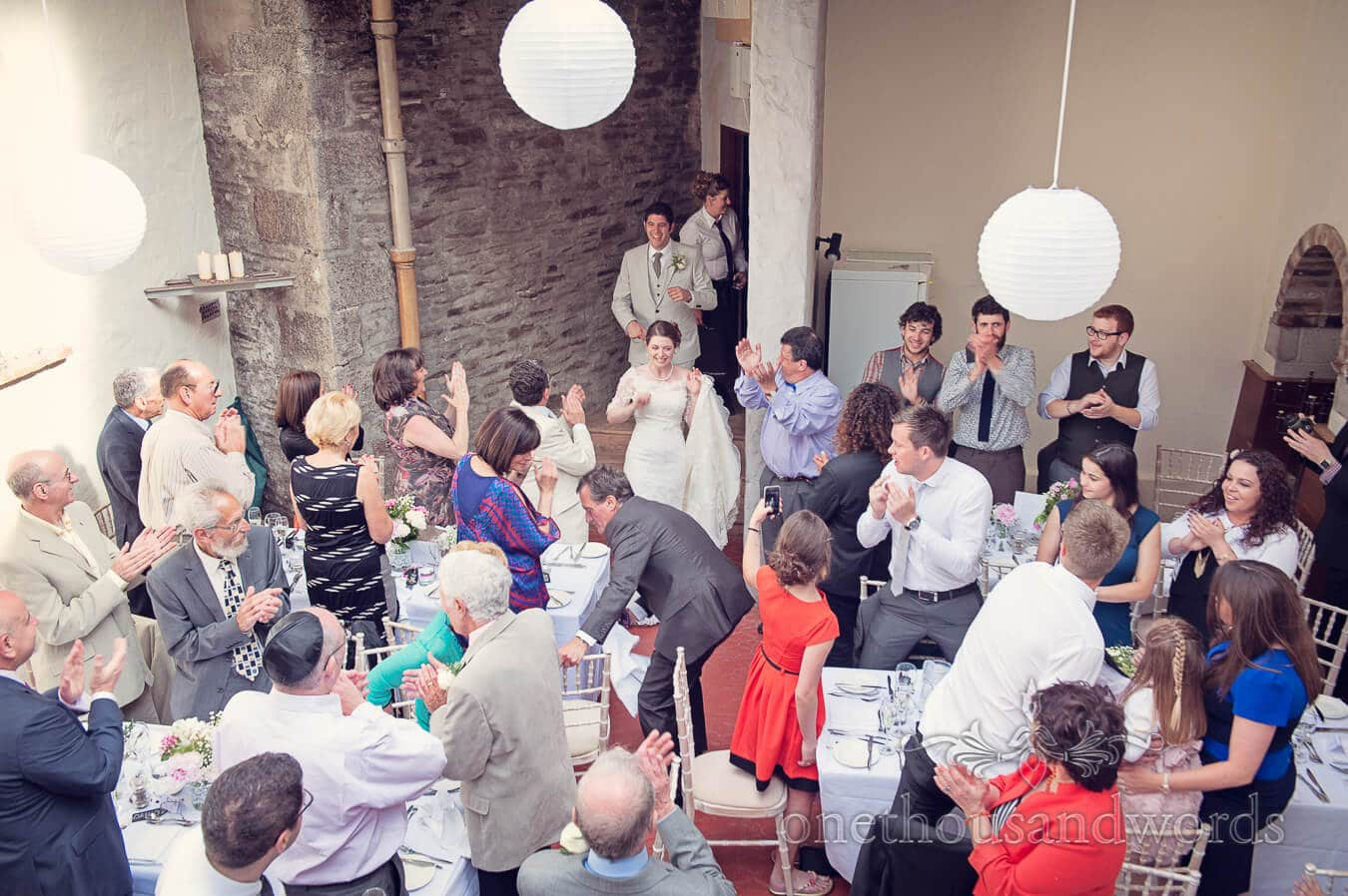 Bride and groom enter Prussia Cove Wedding breakfast