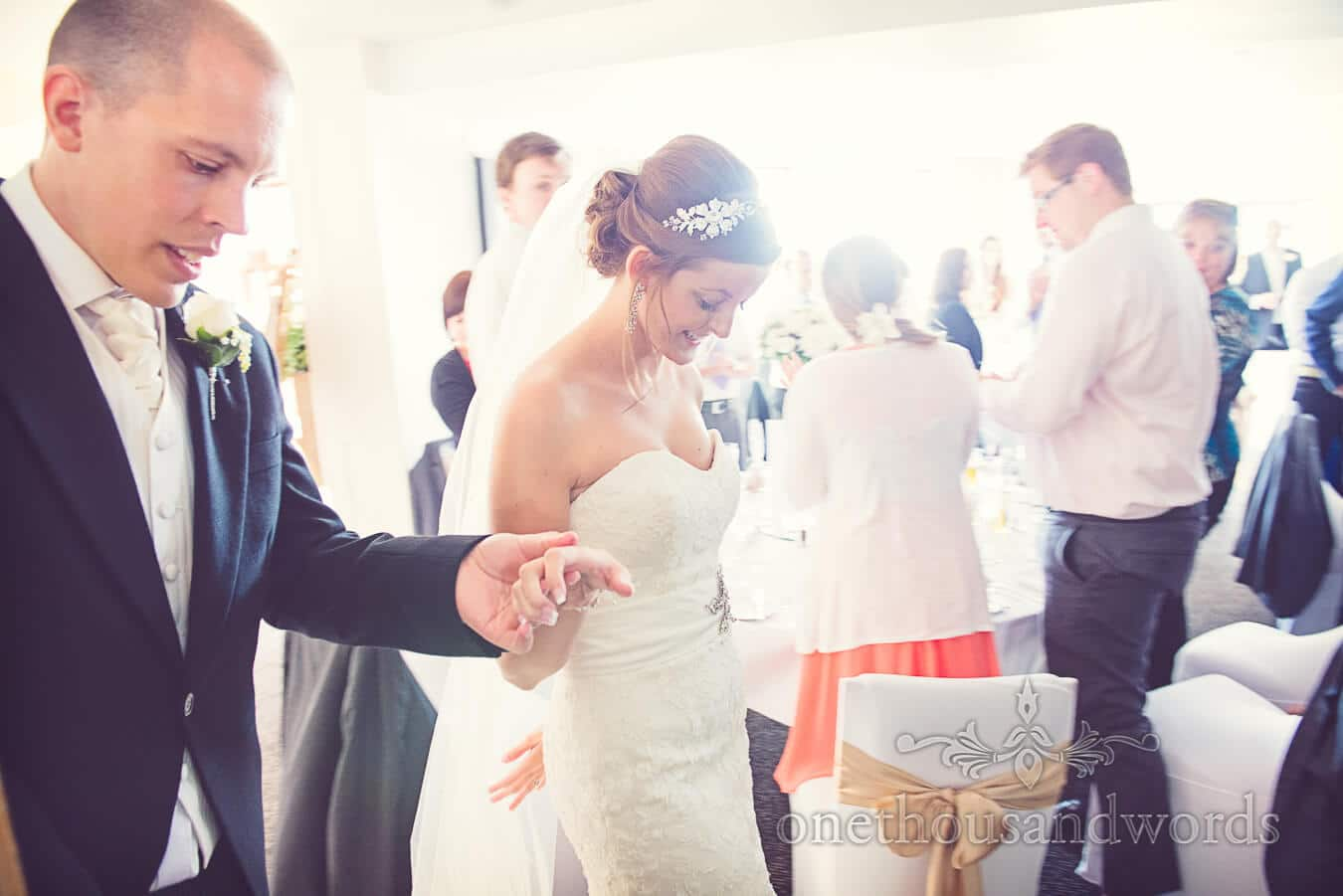 Bride and groom enter wedding breakfast at Poole wedding venue
