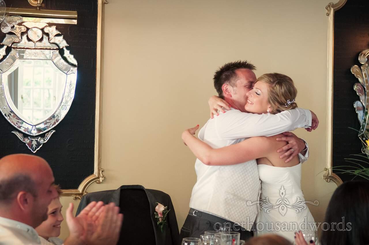 Bride and Groom hug at Lord Bute wedding photographs