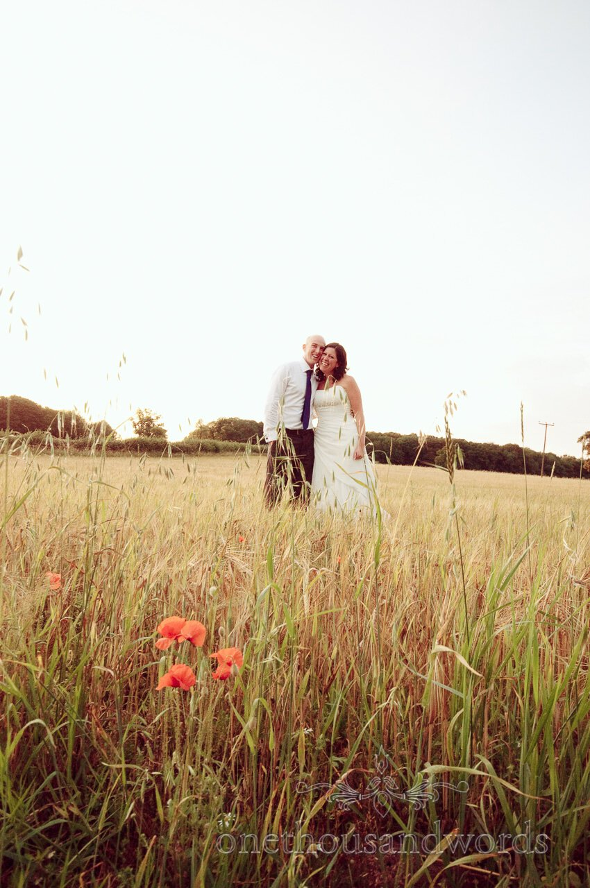 Bride and Groom in english countryside field
