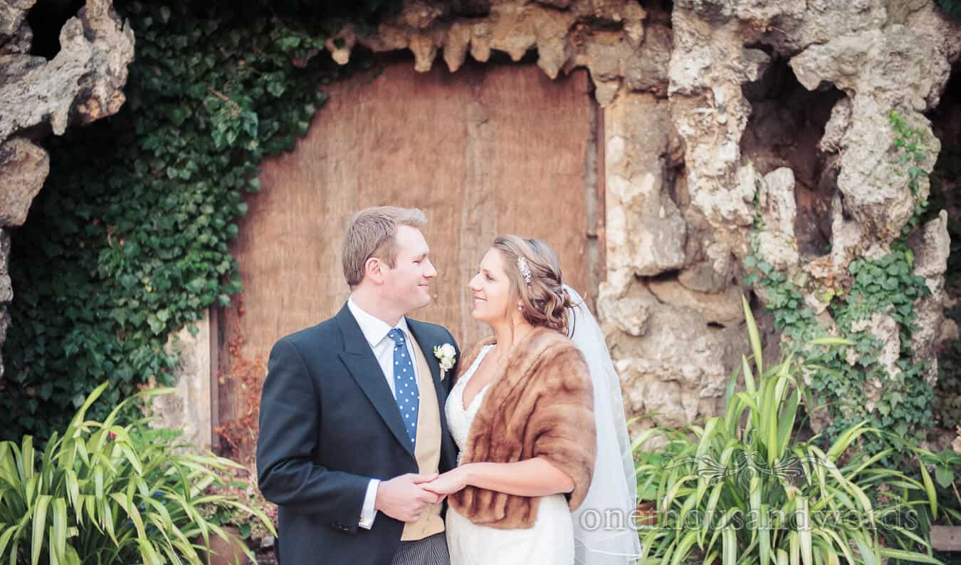 Bride and Groom in Gardens at Hampton Court House Wedding