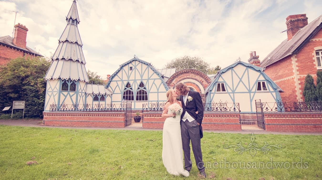 Bride and groom kiss outside Tenbury Wells Pump Rooms wedding venue
