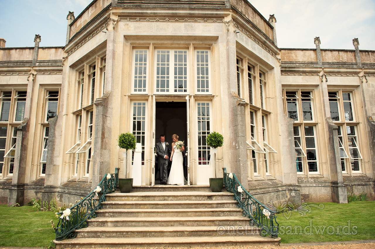 Bride and Groom leave Highcliffe Castle Wedding ceremony in Dorset
