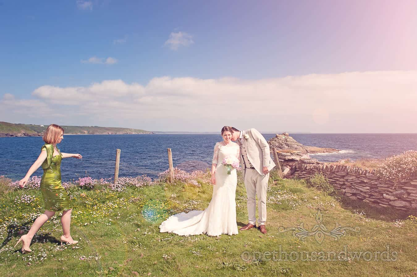 Bride and groom photograph by the sea in Cornwall