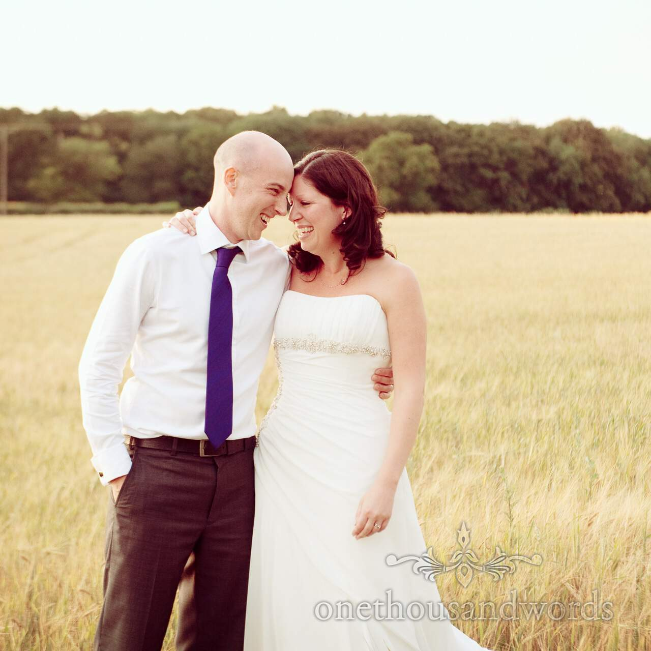 Bride and groom portrait in field