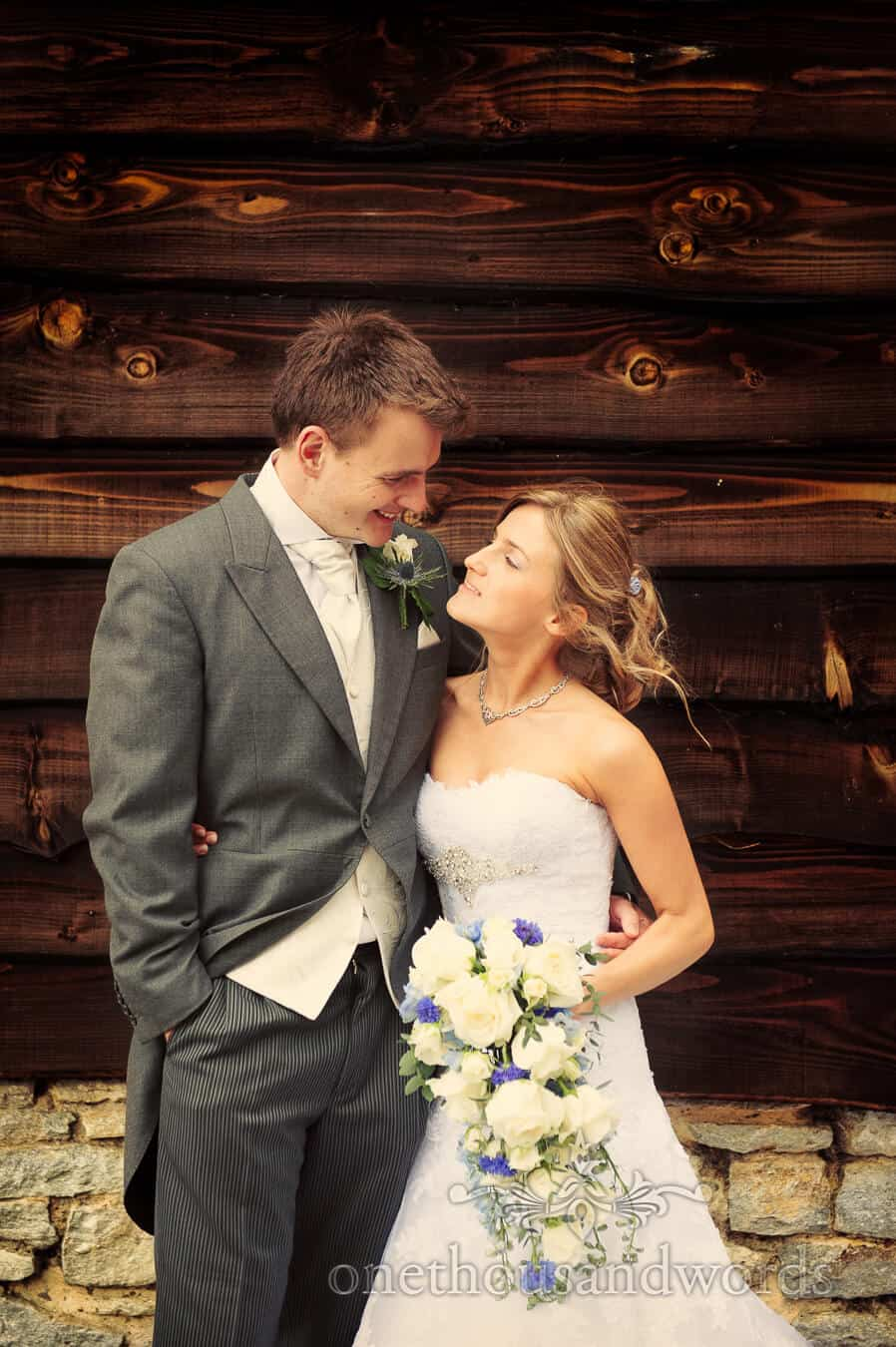 Bride and groom portrait with wood backdrop at Country Theme Wedding
