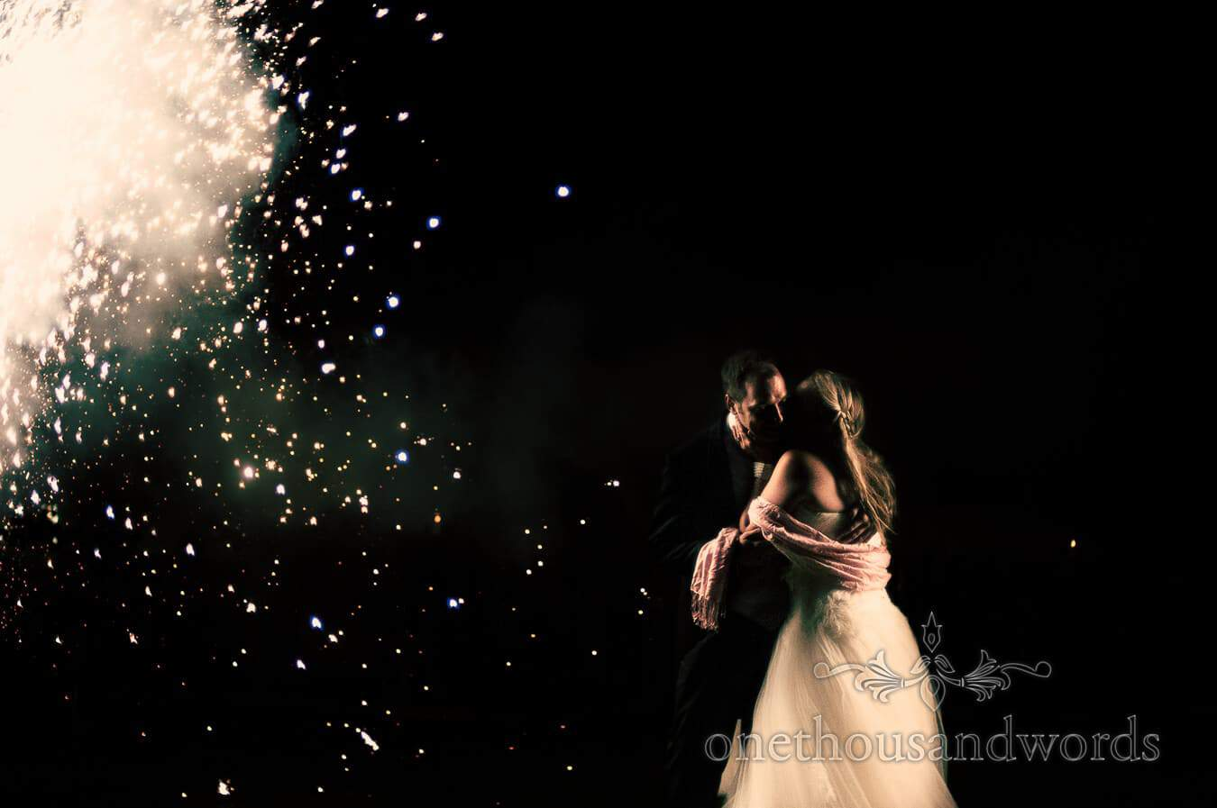 Bride and groom with wedding fireworks wedding photograph