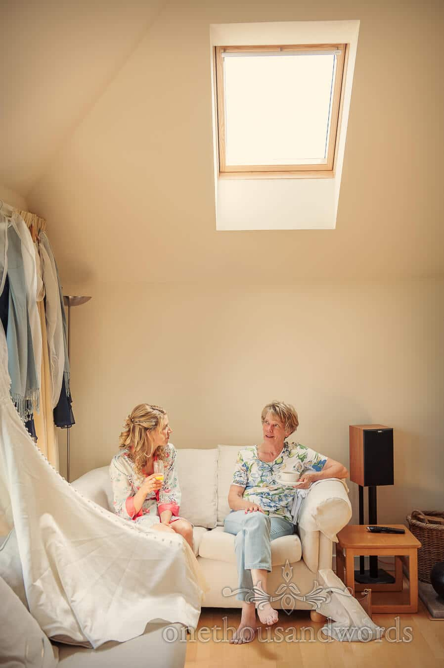 Bride and mother chat on wedding morning in Swanage, Dorset